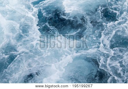 Sea water ship trail with foamy wave. Tropical islands ferry travel. Cruiseliner seawater trail. Deep ocean top view. Big ship pitching image. White swirl wave in sea. Marine travel banner template