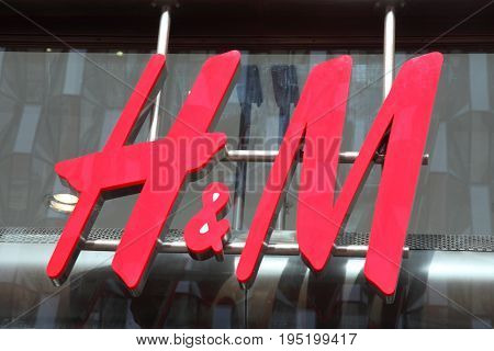 London, UK, April 2, 2011 :  H & M advertising sign outside their retail branch in Oxford Street