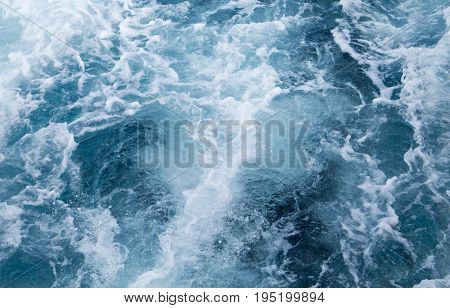 Sea water ship trail with white foamy wave. Tropical islands ferry travel. Cruiseliner seawater trail. Deep ocean top view. Big ship pitching image. White water wave in the sea. Exotic island hopping