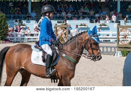 DEVON, PA - MAY 25: View of Riders performing with their horses at the Devon Horse Show on May 25, 2014