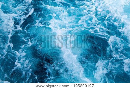 Sea water ship trail with white foamy wave. Tropical islands ferry travel. Cruise liner seawater trail. Blue ocean top view. Big ship pitching image. White water wave in the sea. Exotic island hopping
