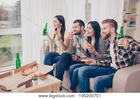 Leisure time! Happy friends watching together football on tv eating pizza and drinking beer