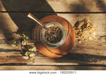 High angle view of  Argentinean yerba mate drink on a wooden background