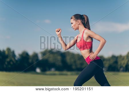 Profile Cropped Photo Of Young Lady Athlete, Running Outdoors, Training For Marathon Run, In Fasiona