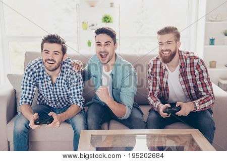 Yes! Our Team Is Winning! Competition Of Guys Playing Car Race. Three Excited Friends Are Playing Ga