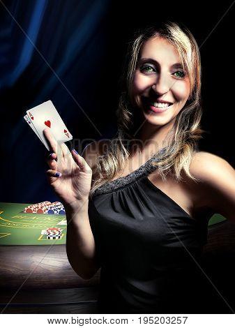 gambler woman win at blackjack casino table