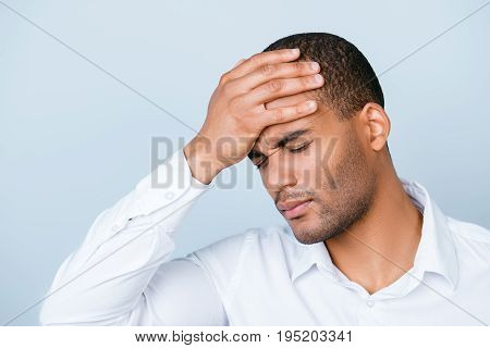 Strong Headache. Tired Sick Handsome Young Mulatto Man With Strong Migraine Grimace. He Is Wearing T