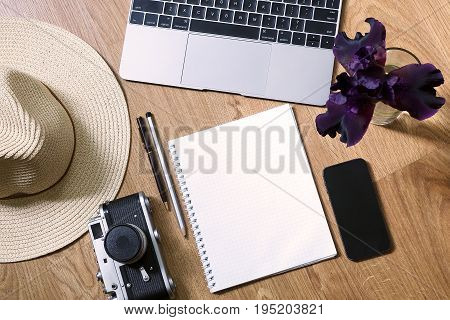 Working Space Of The Blogger Before The Vacation - A Laptop, A Notebook, A Pen, A Pencil, A Phone, A