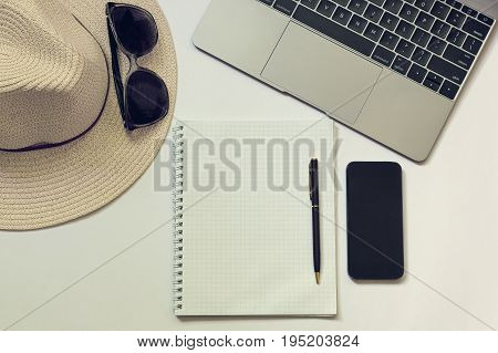 Workplace Of A Blogger, Writer Or Freelancer With A Laptop, Notebook, Phone, Pen, Hat. White Backgro