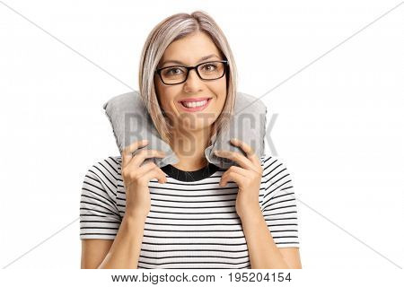 Woman with a neck pillow looking at the camera and smiling isolated on white background