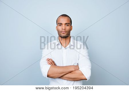 Successful Young Handsome Mulatto American Guy Banker In Formal Outfit On Pure Background With Cross