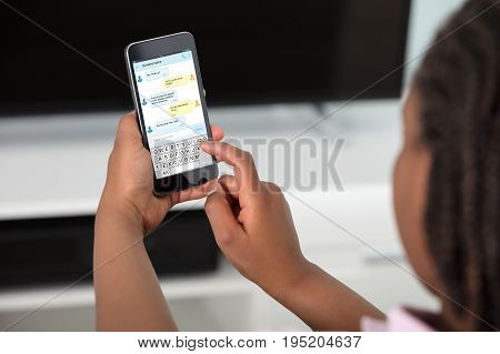 Close-up Of A Girl Sending Text Messages Using Smart Phone