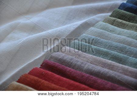 colorful curtain fabric samples closeup, woven textile