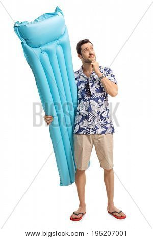 Full length portrait of a pensive tourist with an air mattress isolated on white background