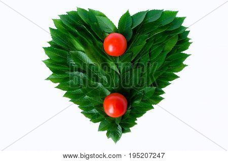 Tomatoes On The Background Of The Heart Of Green Leaves. The Concept Of Love Of Nature And Rational