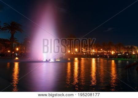 Colorful water fountain. Fountain with night lights