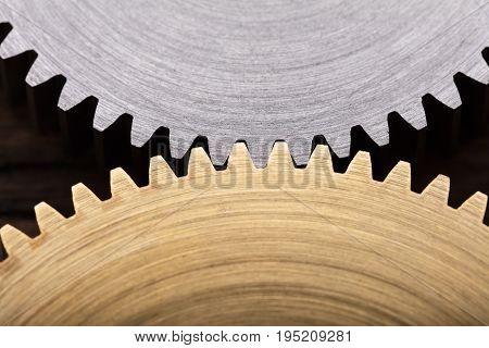 Closeup photo of two interlocking metal gears
