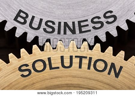 Closeup of business solution concept on interlocked cogwheels