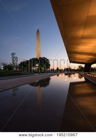 Reflection of Washington Monument in calm reflecting pool at sunset