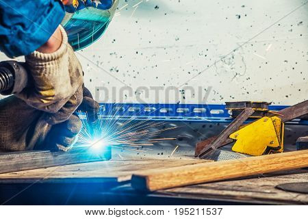 Close Up Man Weld A Metal Welding Machine