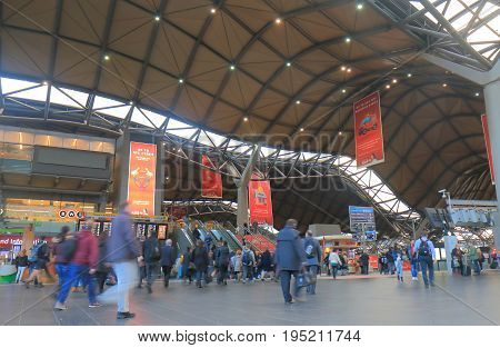 MELBOURNE AUSTRALIA - JULY 3, 2017:Unidentified people travel at Southern Cross Station. Southern Cross Station is the most important rail terminal and public transport interchange in Victoria