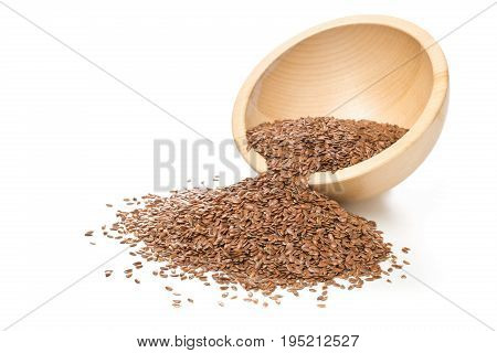 Raw unprocessed linseed or flax seed in wooden bowl over white background