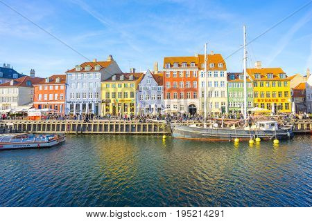 Nyhavn With Colorful Facades Of Old Houses In Copenhagen, Denmark