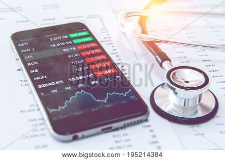 Business concept. Financial analysis Smartphone and Stethoscope.Vintage tone.