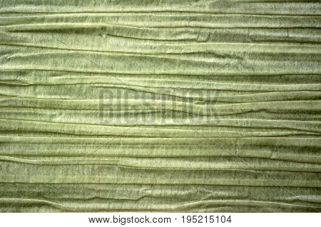 A full frame photograph of wrinkled discolored paper.