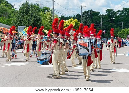 MENDOTA, MN/USA - JULY 8, 2017: Sibley High School marching band performs at the annual Mendota Day Parade. The historic city is one of the first permanent settlements in Minnesota.