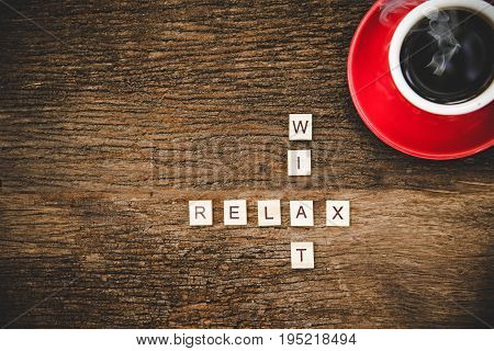 Words of business concepts collected in crossword with coffee cup on wooden cubes. Concept business