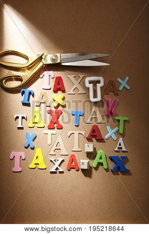 scissors on lot of word  tax