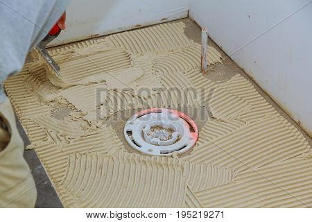 Master Puts On The Floor Adhesive For Tiling