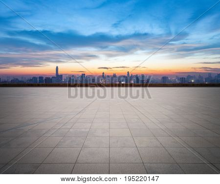 empty concrete floor with cityscape and skyline in sunset bangkok thailand.