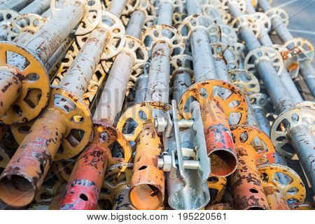 a pile of scaffold pipe building materials closeup