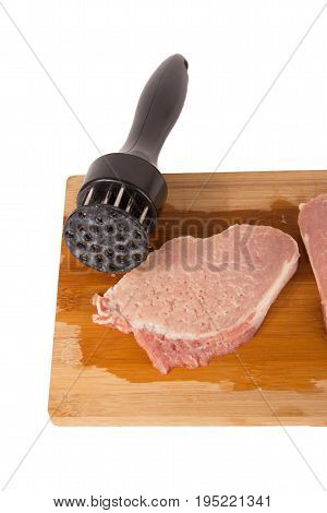 beat the meat and make it soft on a wooden board on a white background