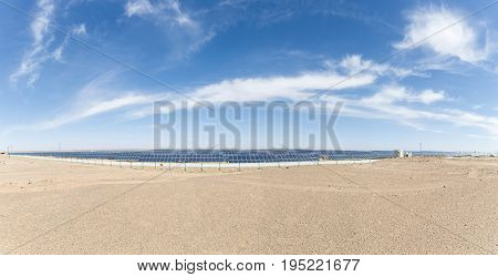 a panoramic view of solar panels on the gobi desert new energy background