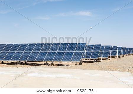 solar panels on the gobi desert clean energy against a blue sky