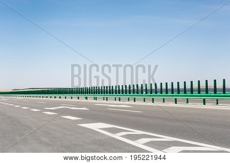 highway on gobi desert with solar power station background