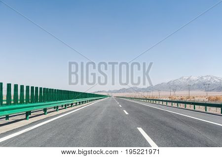 highway on gobi desert long road with wilderness background