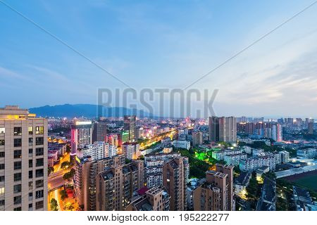 jiujiang cityscape in nightfall beautiful small city in south of the yangtze river China