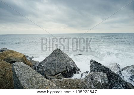 Wave Hits The Rock On The Beach