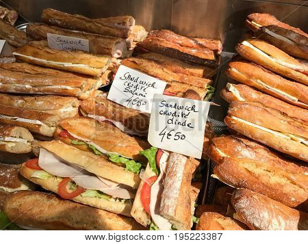Fresh French Baguettes for sale in a window in Paris France.