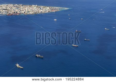 Cargo ships floating near the Male city capital of Maldives view from seaplane window