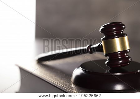 Gavel and the books. Place for typygraphy. Law symbols. Lawyer theme.