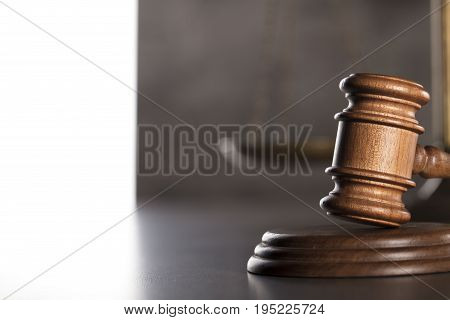 Law and business theme. Gavel on gray background.