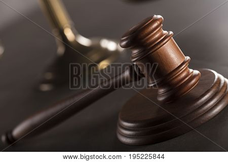 Gavel on the gray background. Place for typygraphy. Law symbols. Lawyer theme.