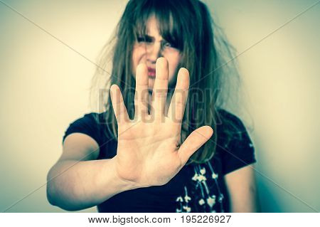 Disgusted woman is showing stop gesture with her hand - retro style