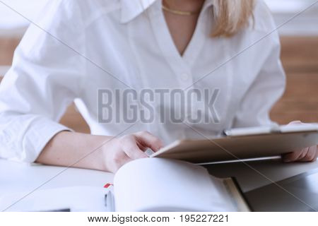 Female Hands Hold Clipboard Pad With Financial Statistics