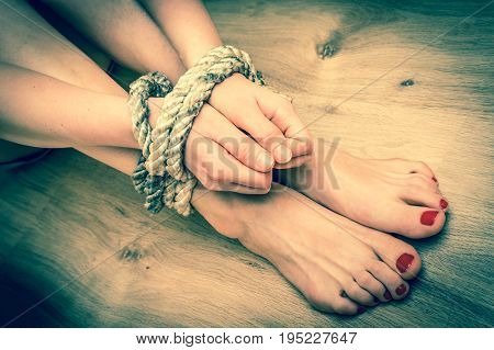 Female Legs Tied With Rough Rope